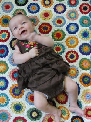 Cheerful baby, cheerful blanket