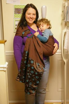 me and my sleepy toddler modelling the ring sling