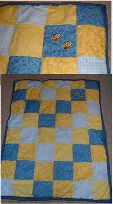 Full quilt and close up of bee applique